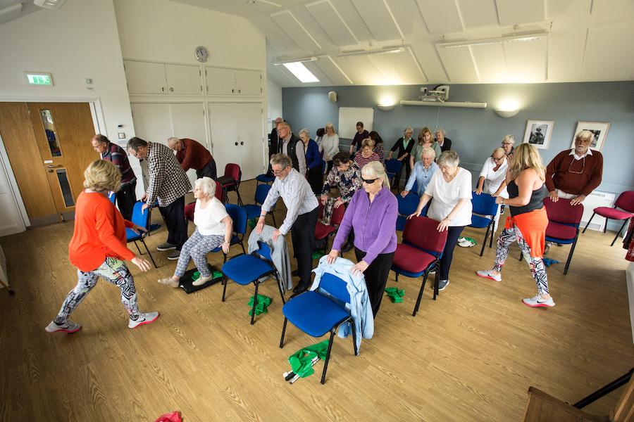 Elderly people doing gentle exercise